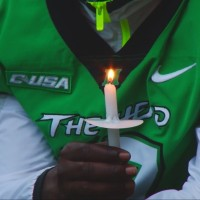 Marshall Gathers to Pray for Former QB Reggie Oliver
