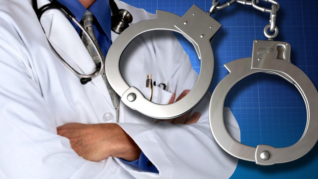 Doctor Handcuffs Doctor Arrest _1545344741713.jpg